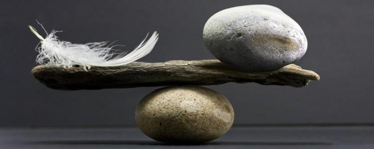 cropped-bigstock-feather-and-stone-balance-5254698.jpg