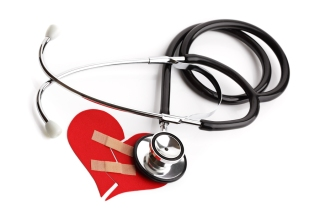 Stethoscope and broken heart concept for heart disease or illnes